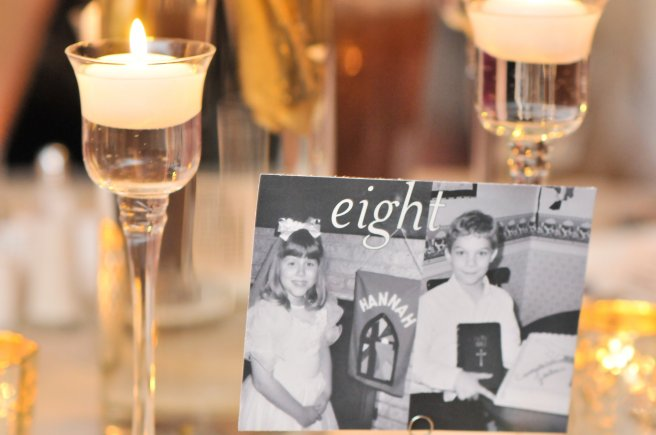 We paired childhood photos of the couple with the corresponding table number.